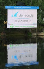 Barracuda sign is reflected in a pond along the 18th hole at Montreux.