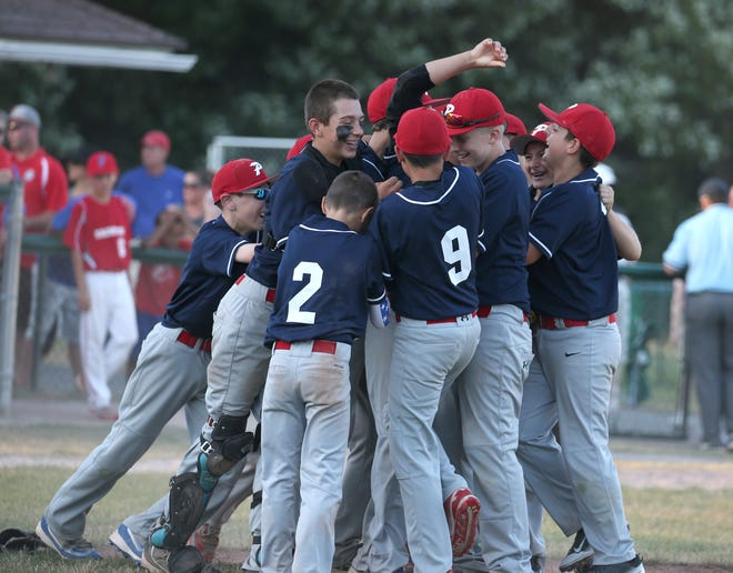 Penfield players mob teammate and closing pitcher Noah Rogoff after the final out giving them the victory during the District IV Little League Baseball Tournament finals Thursday, July 14, 2016 at the Penfield Little League Complex. Penfield Little League is hosting the state tournament this week.