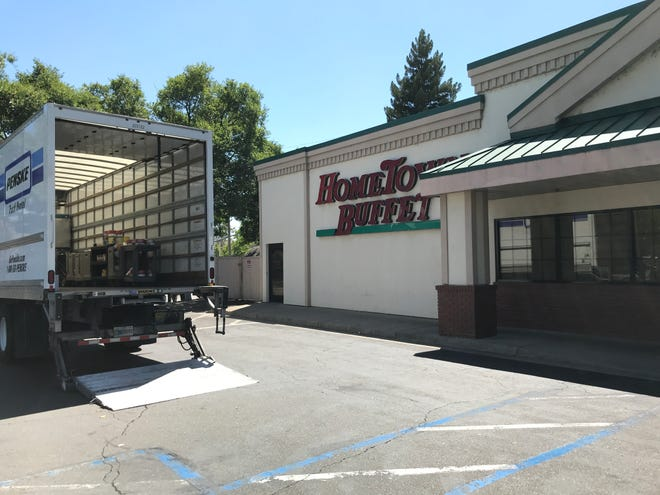 A truck sits in front of HomeTown Buffet on Churn Creek Road on Monday afternoon.