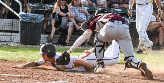 Colt 45s' Brendan Roop is tagged out at home by Jacob Cobb at Tiger Field on Sunday, July 21.
