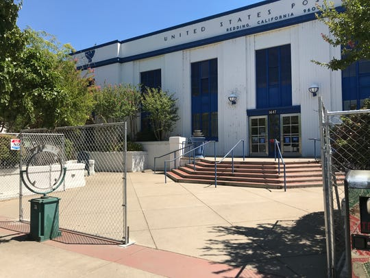 A temporary chain-link fence has been installed around the post office in downtown Redding to combat camping and other illegal activity. A permanent wrought-iron fence is expected to replace the chain-link fence in September.