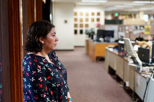 Jenny Espino, local editor of the Record Searchlight, directs a news meeting in the newspaper's newsroom during coverage of the Carr Fire Aug. 1, 2018.