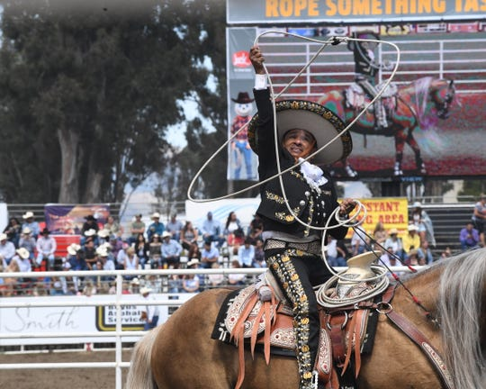 Tomas Garcilazo performs his traditional charro rope routine at the California Rodeo Salinas on July 21, 2019.