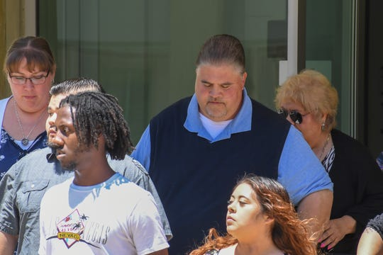 Former North Salinas coach John Anthony Fickas exits Monterey County Superior Court Monday after his arraignment hearing.