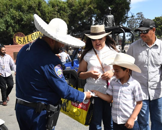 Wearing a traditional Mexican charro outfit, Salinas Police Officer Robert Hernandez does outreach at the California Rodeo Salinas on July 21, 2019.