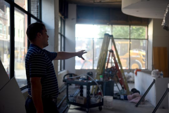 Developer Bret Davis details the future home of Angello's Scoops coming downtown, sharing the vision for the space as construction continues in the One Plaza East building at 100 E. Main St., in Salisbury, Maryland, on July 22, 2019.