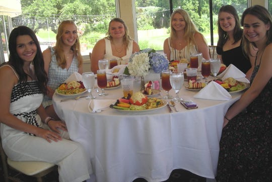 Let's eat!  Demoiselle Club Debs settle down for a bountiful salad lunch at East Ridge Country Club during the Bunco Party: Reagan Stewart, Natalie Lukacs, Helen Jackson, Olivia Morgan, Sarah Grace Prestwood, Audrey Bergeron.