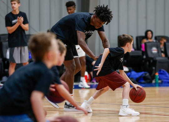Indiana Pacers forward and Missouri State alumnus Alize Johnson works with a camper during a drill at The Basketball Movement in Nixa, Mo., on Monday, July 22, 2019.