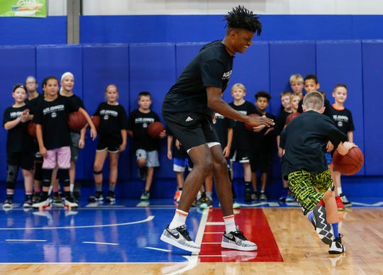 Indiana Pacers forward and Missouri State alumnus Alize Johnson goes one-on-one with Ryker Letterman during his basketball camp at The Basketball Movement in Nixa, Mo., on Monday, July 22, 2019.
