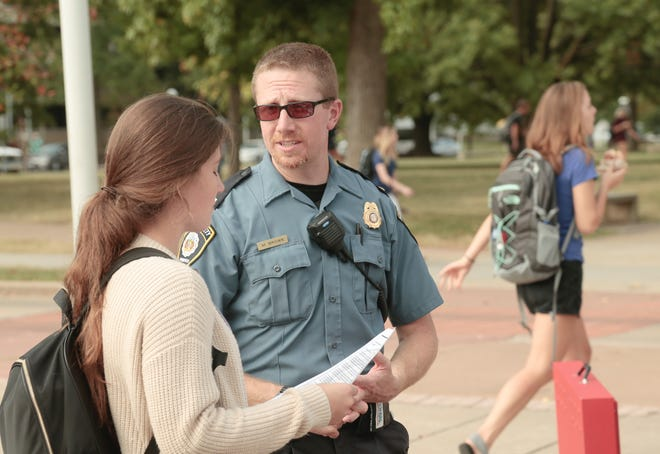 Matthew T. Brown, manager of campus safety at Missouri State University, interacts with a student.
