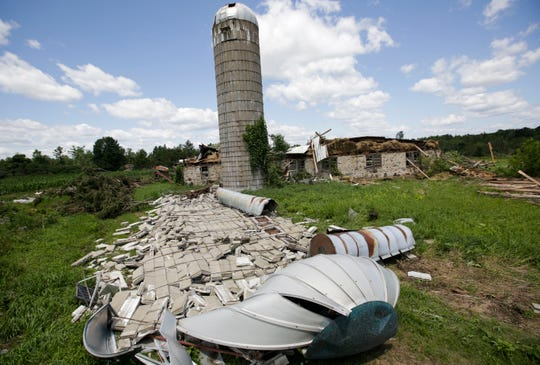 The remains of a fallen grain silo lie on Lorraine Wojdac's property on July 22, 2019, in Knowlton. An EF-1 tornado touched down near Knowlton and hit the farm as a series of severe storms rolled through the region. Photographer Tork Mason earned a second-place award for spot news photo for the image in the Wisconsin Newspaper Association's 2019 Better Newspaper Contest.