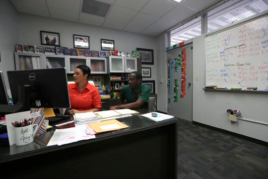 Pineview Elementary principal Carmen Conner, left, and assistant principal Oronde McKhan sit in Conner's office to go over school data Monday, July 22, 2019. Pineview Elementary principal Carmen Conner