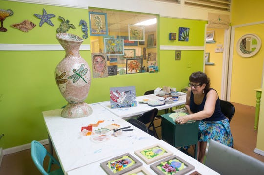 Pelican Central Mosaic Arts, owned by Diane Concepción (pictured) and Asia Booth and located in downtown Fort Pierce, offers open studio hours, lessons and organized classes to help people at any skill level to create colorful mosaics. For more information, call 772-804-4715 or go to www.facebook.com/pelicancentral.