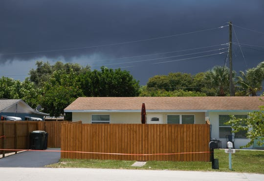 The 6-foot fence at 402 Fini Drive in Stuart has led to city officials questioning whether to lower the height limit on fences.