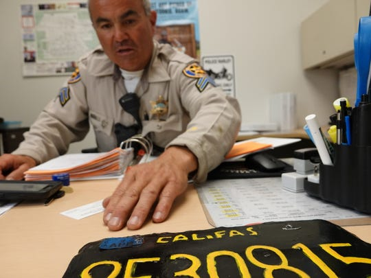A phony big-rig license plate that made headlines around the country in June decorates the office of Ventura County Sheriff's Office Senior Deputy David Anaya, who pulled the truck over in Moorpark.