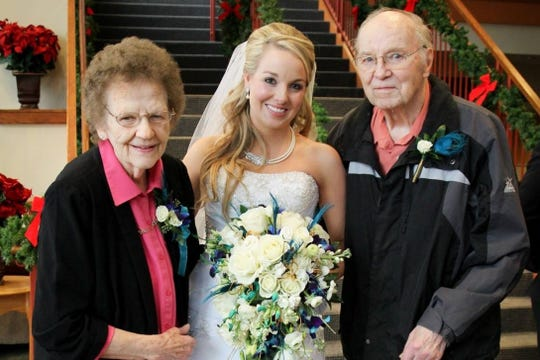 Lindsey Jensen is flanked by her grandparents Mary and Don Schultz at her wedding.