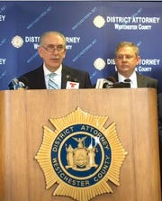 William Schaeffer, Second Deputy District Attorney, right, listens as Westchester County District Attorney Anthony Scarpino, Jr. speaks during a press conference in June 2019.