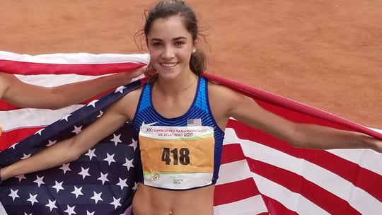 Lydia Olivere after winning the 3,000-meter steeplechase gold medal at the PanAmerican U20 Championships in Costa Rica.
