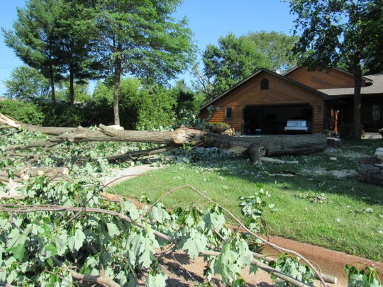 Jim and Judy Spanfellner lost nine large trees around their home near the corner of 18th Street South and East G Street in Wisconsin Rapids following a weekend storm that left widespread damage across the area. The couple said they still were without power Monday, July 22, 2019, as they worked to remove debris.