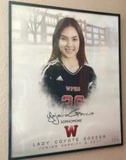 Yajaira Garcia pictured in a Lady Coyote soccer poster.