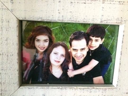 The Garcia family in better times in a photo displayed in their living room.