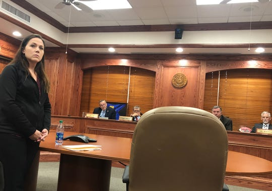 Amanda Brumley, Wichita County's human resources director and the commissioners court listen to testimony from witnesses Monday morning concerning allegations that Brumley falsified an email. Brumley denied the claim.