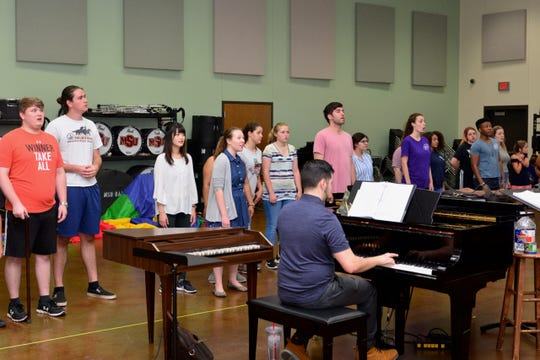 """Members of the cast of """"The Little Prince"""" rehearse the finale of the opera"""