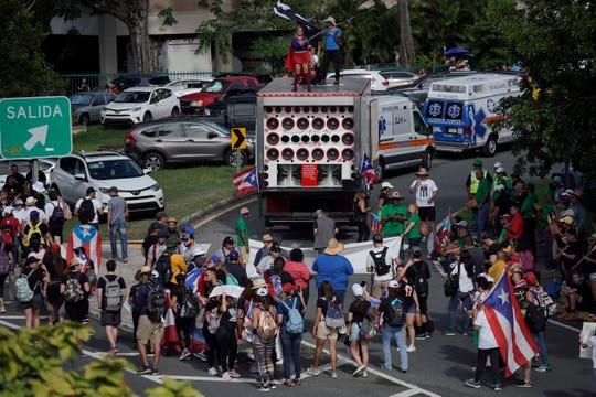 People take to the Las Americas Highway in San Juan on July 22, 2019, demanding the resignation of Gov. Ricardo Rosselló.