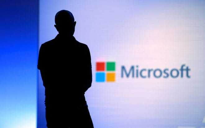 In this May 7, 2018, file photo Microsoft CEO Satya Nadella looks on during a video as he delivers the keynote address at Build, the company's annual conference for software developers in Seattle. Microsoft is paying more than $25 million to settle federal corruption charges involving a bribery scheme in its Hungary office and three other foreign subsidiaries, the U.S. Securities and Exchange Commission said Monday, July 22, 2019.