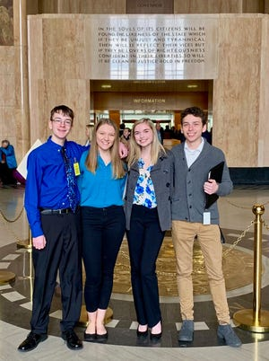 In this Feb. 6, 2019 photo provided by Providence Health & Services, from left, Sam Adamson, Lori Riddle, Hailey Hardcastle, and Derek Evans pose at the Oregon State Capitol in Salem, Ore.