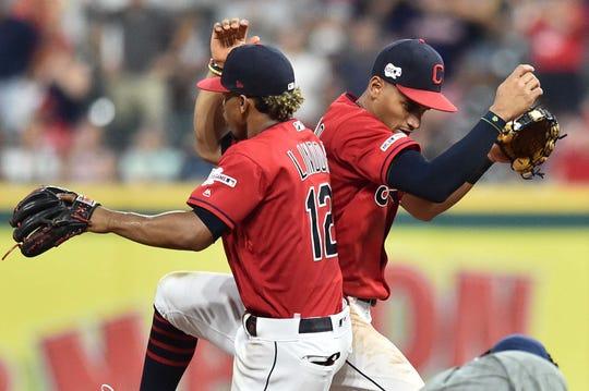 Indians' Francisco Lindor and Oscar Mercado celebrate a win.