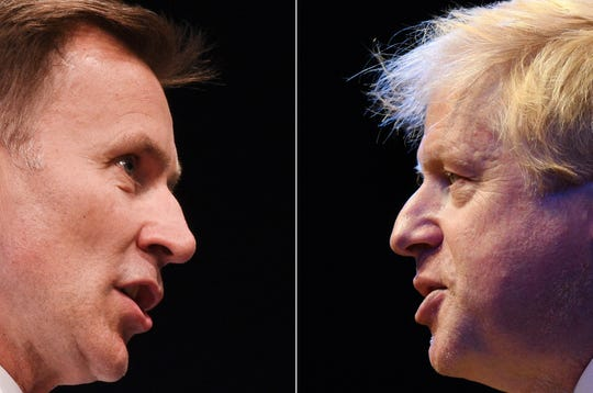 A combination of pictures shows the two British Conservative Party leadership candidates: Boris Johnson, right, and Jeremy Hunt, on July 4, 2019.