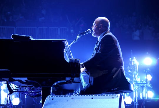 NEW YORK, NY - DECEMBER 31:  Billy Joel performs onstage during his New Year's Eve Concert at the Barclays Center of Brooklyn on December 31, 2013 in New York City.  (Photo by Kevin Mazur/WireImage) ORG XMIT: 460796887 ORIG FILE ID: 459842545