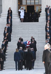 The casket of retired Associate Justice John Paul Stevens arrives and will lie in repose in the Great Hall of the Supreme Court in Washington, D.C., on Monday, July 22, 2019.