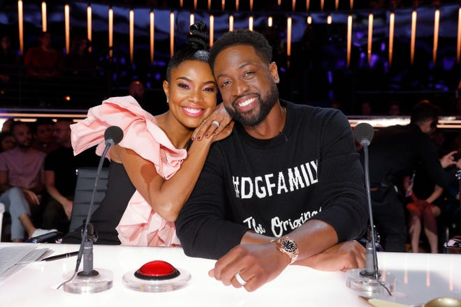 First-season 'America's Got Talent' judge Gabrielle Union, left, welcomes her husband, recently retired NBA superstar Dwyane Wade, as a guest judge during Tuesday's Judge Cuts elimination round of the NBC talent competition.