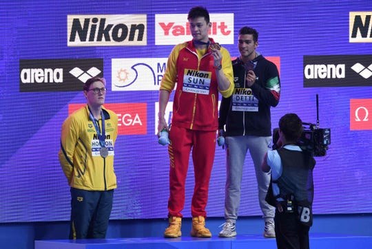 Australia's Mack Horton (left, silver medalist) refuses to stand on the podium with China's Sun Yang (center, gold medalist) and Italy's Gabriele Detti (right, bronze medalist) after the final of the men's 400m freestyle event at the 2019 World Championships at Nambu University Municipal Aquatics Center in Gwangju, South Korea.