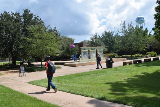 Students walk across the campus at Louisiana State University of Alexandria. Several local legislators stressed the need to boost LSUA's profile as a future priority.