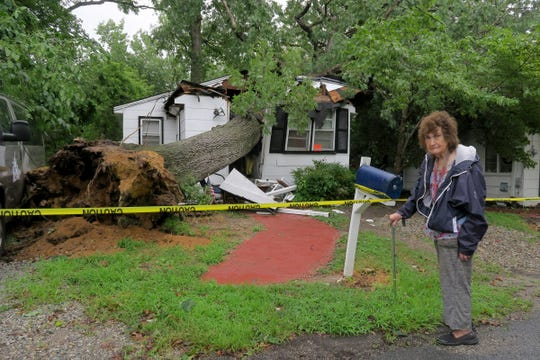 June O'Hagan walks past the Courtland Street home she owns in Neptune Township Tuesday morning, July 23, 2019.  The home, which was occupied by another person, was heavily damaged by a fallen tree Monday night.