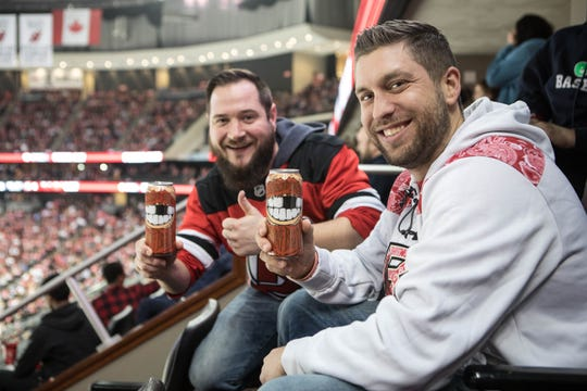 New Jersey Devils fans, beers in hand, at the Prudential Center in Newark.
