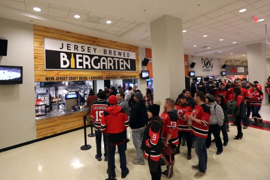 New Jersey Devils fans line up at the Jersey Brewed Biergarten at the Prudential Center in Newark.
