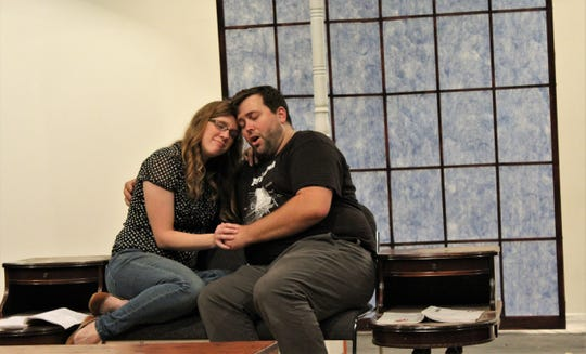 "Agnes (Ashleigh Goff) and Michael (Kerry Goff) share a tender moment during her pregnancy in this rehearsal scene from McMurry University's summer musical ""I Do! I Do!"""