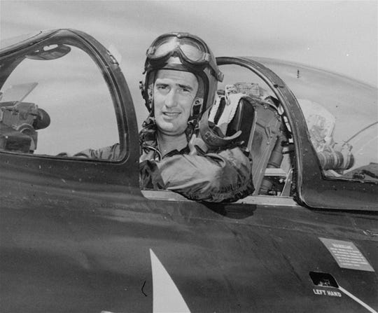 Ted Williams, former Boston Red Sox slugger, is shown in cockpit of a Marine F9F-5 Panther jet fighter plane while taking a refresher course in Sept. 1952.