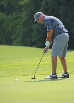 Defending champ Chris Kallgren putts on No. 18 during the first day of the City  Senior Golf Championship at Cedar Creek Golf Club on Tuesday.