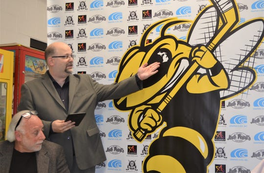 Adam Stio, General Manager of the  Battle Creek Rumble Bees, shows off the logo of the newest professional hockey franchise in town at a press conference at The Rink on Tuesday.