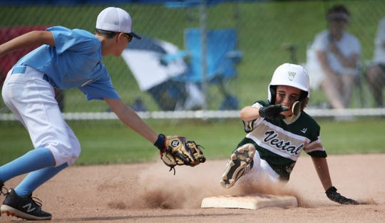 Vestal's Will Washburn (12) slides into second against Oceanside Tuesday at the New York State Little League Championships in Penfield. Oceanside won, 5-4.