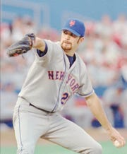 New York Mets starting pitcher Bill Pulsipher winds up during the first inning against the St. Louis Cardinals in St. Louis Wednesday, July 19, 1995.(AP Photo/James A. Finley)