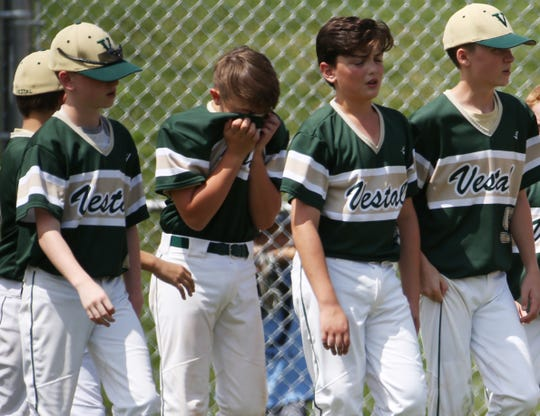Vestal players react after Tuesday's 5-4 loss to Oceanside in the first game of pool play at the New York State Little League Championships in Penfield.