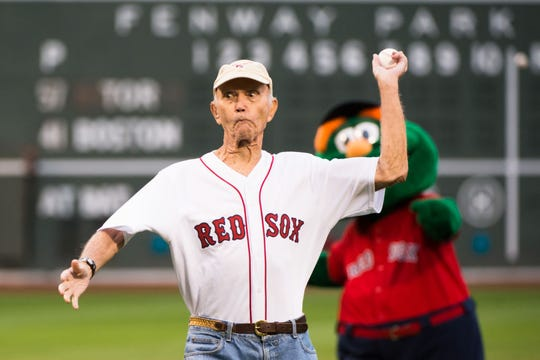 Former  astronaut Michael Collins throws out the ceremonial first pitch in honor of the 50th anniversary of Apollo 11 at Fenway Park on June 21, 2019 in Boston, Massachusetts.