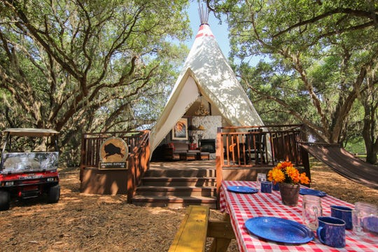 The 651-square-foot luxe teepees include a king bed, a sleeper sofa, a full bathroom, microwave, refrigerator, of course air conditioning and even a fireplace.