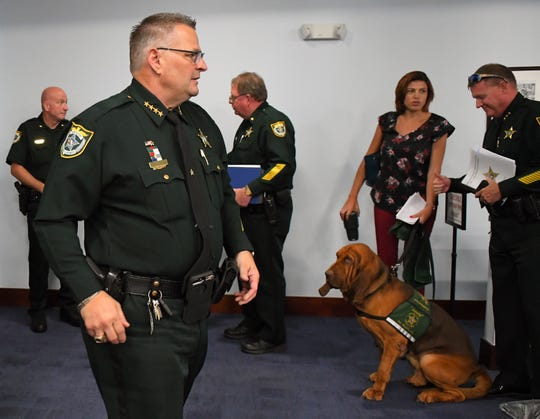 Sherrif Wayne Ivey, with BCSO dog Junny looking on, after the commssioners voted 4-1 to appove Resolution for Finding of Critical Needs, Law Enforcement Municipal Service Taxing Unit, at the July 23 meeting of the Brevard County Board of Commissioners in Viera.